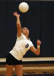 Girl serving volleyball